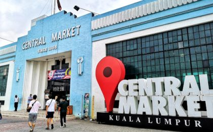 Central Market Drop Pin, next to the entrance of the iconic blue facade