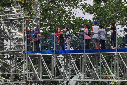 Visitors are waiting for their turnm to climb up to the highest tower